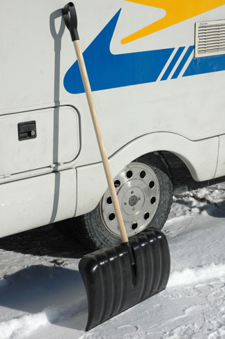 Clearing The Snow From  A Concore Motorhome